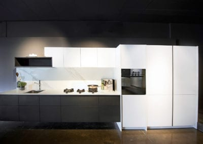 Rempp Rockface and Lacquer floating kitchen with feature open shelving and PITT cooktop